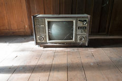 Retro tv with wooden case in room Royalty Free Stock Image