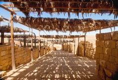 Retro twiggen awning in old desert city Stock Photo