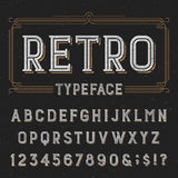 Retro typeface with distressed overlay texture. Royalty Free Stock Photo