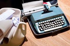 Retro Typewriter. A retro typewriter with scroll of paper in a artistic bin stock photography
