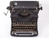 Retro typewriter. On a white background Stock Photos