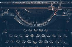 Retro Typewriter. Aged Retro Typewriter in Dark Blue Color Grading. Typewriter Front View Royalty Free Stock Photo