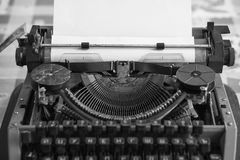 Retro typewriter with blank sheet. Of paper in black and white vintage style. back to school. low angle shot Royalty Free Stock Images
