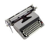 A Retro Typewriter Circa 1960s. An old fashioned antique typewriter on white royalty free stock images