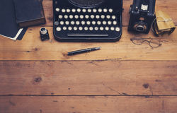 Retro typewriter hero header. Top view retro writers office desk hero header on wooden table top Royalty Free Stock Photography