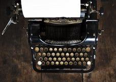 Retro Typewriter Machine Old Style with Blank Paper Stock Photo
