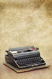 Retro typewriter on the old vintage textured paper background Royalty Free Stock Photography
