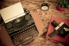 Retro typewriter. With paper blank on wood background. Top view Royalty Free Stock Image
