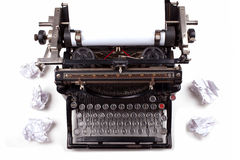 Retro typewriter. With paper scattered all around Royalty Free Stock Photo