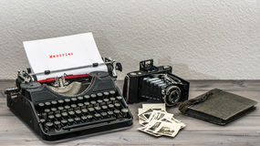 Retro typewriter and vintage photo camera Royalty Free Stock Image
