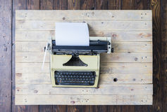 Retro typewriter on a vintage wooden background Royalty Free Stock Images