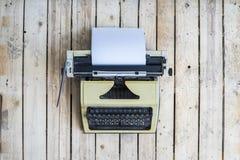 Retro typewriter on a vintage wooden background Stock Photos