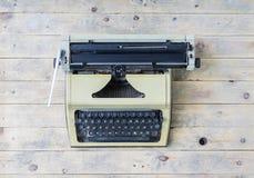 Retro typewriter on a vintage wooden background Stock Photo