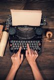Retro typewriter on wooden planks Stock Photography