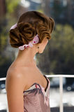 Retro updo woman. Amazing retro style hair updo finished with flowers royalty free stock photography