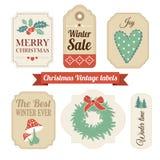 Retro uppsättning av jultappninggåvan, försäljningsetiketter, etiketter Royaltyfri Bild
