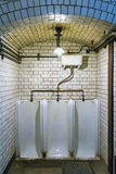 Retro urinal in the old restaurant Stock Images