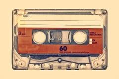 Retro utformad bild av en gammal kompakt kassett arkivfoto