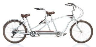 Retro utformad tandem cykel som isoleras på en vit Fotografering för Bildbyråer