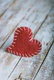 Retro valentine heart on grunge wood background. Stock Photo