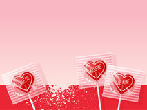 Retro valentine heart shaped lollipops on pink background. Royalty Free Stock Images