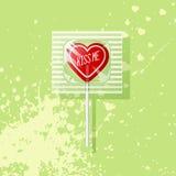 Retro Valentine heart shaped wrapped lollipop Stock Image