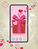 Retro Valentine`s Day Gift Box in Generic Phone. Valentine`s Day Concept Mobile phone with gift box and hearts; rustic and retro styling Stock Image