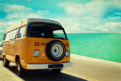 Retro van. Retro beach van driving along coastline Stock Photo
