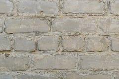 Retro vecchia superficie imbiancata del muro di mattoni Struttura rustica bianca Struttura d'annata Gesso dipinto irregolare mise fotografia stock
