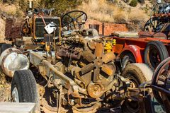 Retro Vehicle Engine In Salvage Yard. Retro Vehicle Engine On Scrapped Automobile Against Hill In Salvage Yard stock photos