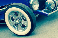 Retro vehicle. Retro toned vintage vehicle with white walled wheels Royalty Free Stock Photos