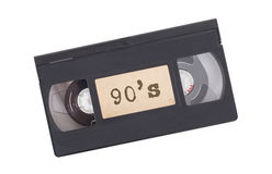 Retro videoband som isoleras på vit Royaltyfria Foton