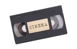 Retro videoband som isoleras på vit Arkivbild