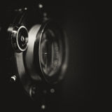 Retro view camera lens with vintage shutter Stock Photos