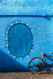 Retro vintage bicycle old and blue wall background design Stock Photos