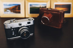Retro vintage camera and photo frames on wood table Stock Image
