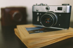 Retro vintage camera and photo frames on wood table Royalty Free Stock Images
