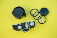A retro vintage camera shot on a colorful background stock photography