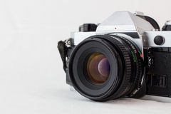 Retro vintage camera on a white background with selective focus Royalty Free Stock Photo
