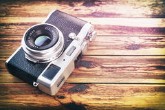 Retro vintage camera on wood table background. Royalty Free Stock Photos