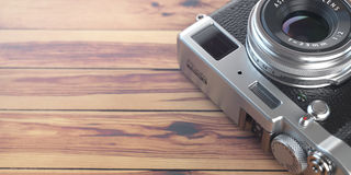 Retro vintage camera on wood table background. Space for text. Stock Photos