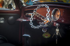 Retro Vintage Car. With a chain steering wheel with the keys in the ignition Stock Images