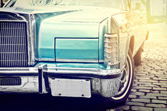 Retro vintage car parked in old city street. Stock Photography