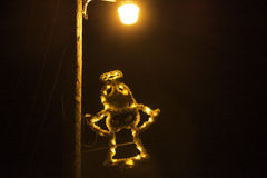 Retro Vintage Christmas Light Angel. Vintage bulb & tinsel Angel smiles from a light pole Royalty Free Stock Images