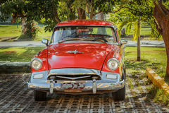retro vintage classic car parked in tropical garde Royalty Free Stock Photos