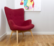 Retro Vintage Classic Red Chair. Retro chair on a grey wall background with part of a painting Royalty Free Stock Photography
