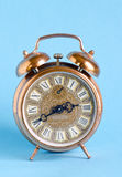 Retro vintage clock roman numbers blue background Stock Photo