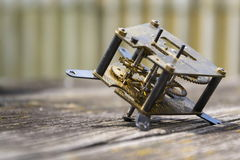 Retro vintage clockwork movement watch mechanism on wood Royalty Free Stock Photos