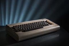 Retro Vintage Computer Commodore 64. Retro Vintage Computer Advertisement of Commodore 64 on an illuminated background Royalty Free Stock Photography