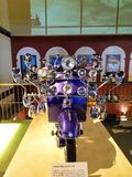 Retro vintage custom scooter having many mirrors, headlight in front. royalty free stock photos